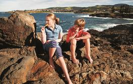 Kids eating ice cream on Kiama beach, South Coast